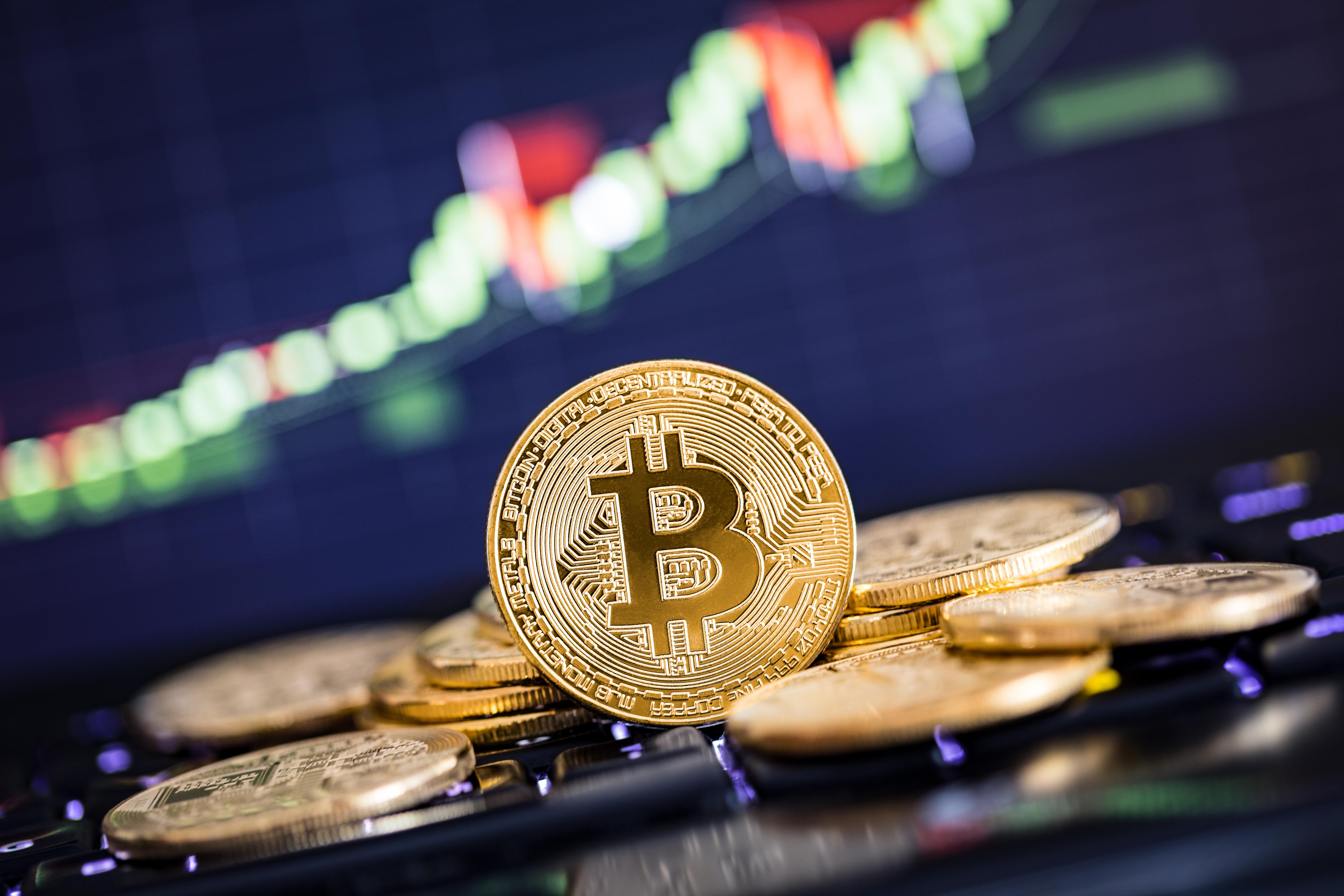 A Bitcoin token set against a falling graph