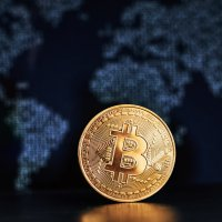 Single bitcoin in front of world map
