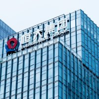 China Evergrande Group icon on office building wall in Shenzen, China