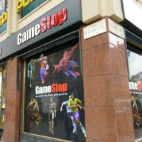 Exterior of a GameStop retail store with a window display of video game characters