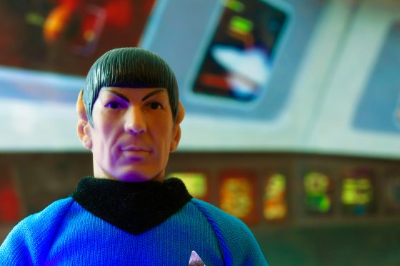 Recreation of a scene from Star Trek the Original Series with a portrait of Mr. Spock at his science station on the bridge of the USS Enterprise - vintage Mego action figure