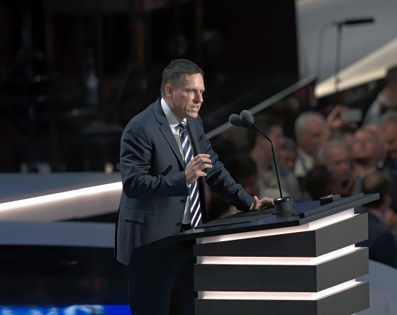 Peter Thiel speaking at a podium
