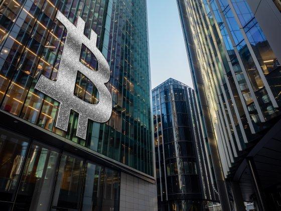 Bitcoin logo superimposed on skyscraper