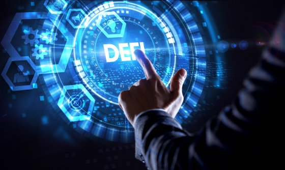 A person pointing to a futuristic blue and white DeFi graphic on a screen
