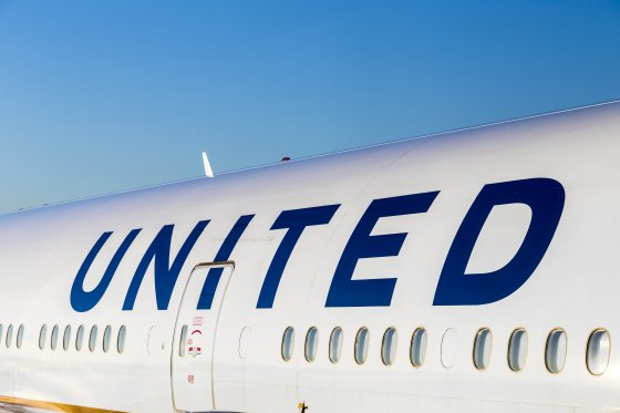 A sideview of a United Airlines jet