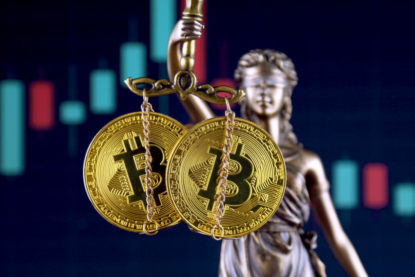 Graphic of law and justice statue holding bitcoin