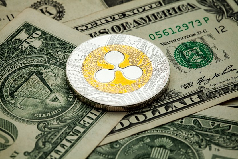 Ripple on a background of US dollars
