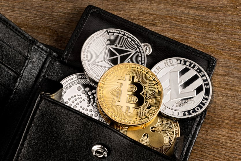 Crypto coins in a leather wallet