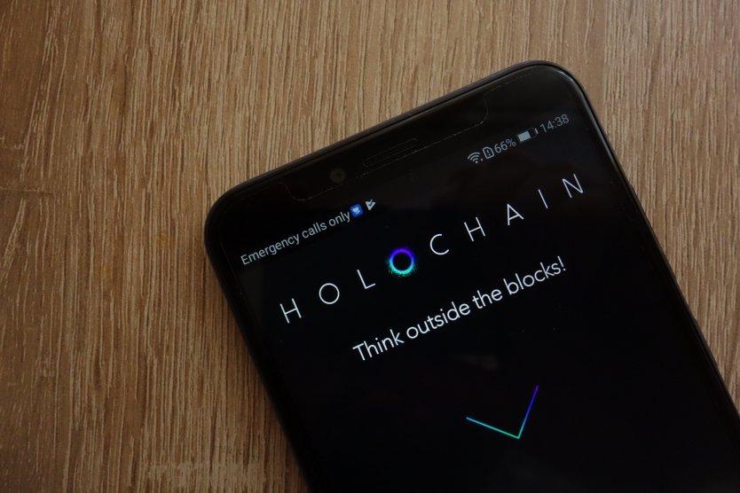 Holochain logo on a smartphone