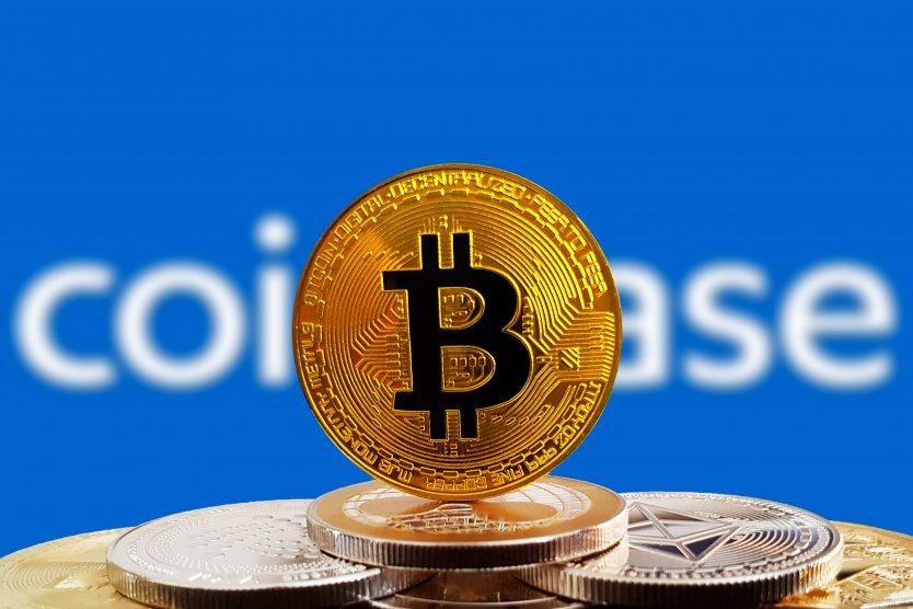 A bitcoin token in front of the Coinbase logo
