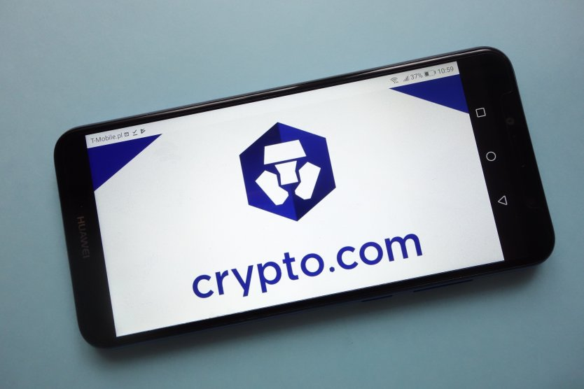 A smartphone showing the crypto.com logo