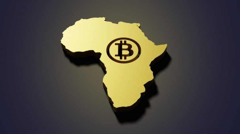 bitcoin symbol in the middle of a map of Africa