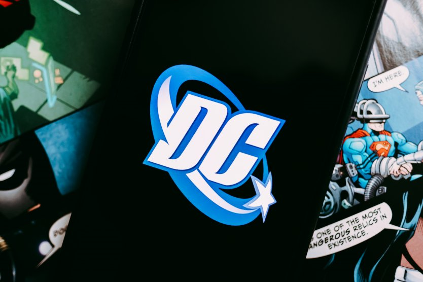iPhone with DC Comics logo on the screen
