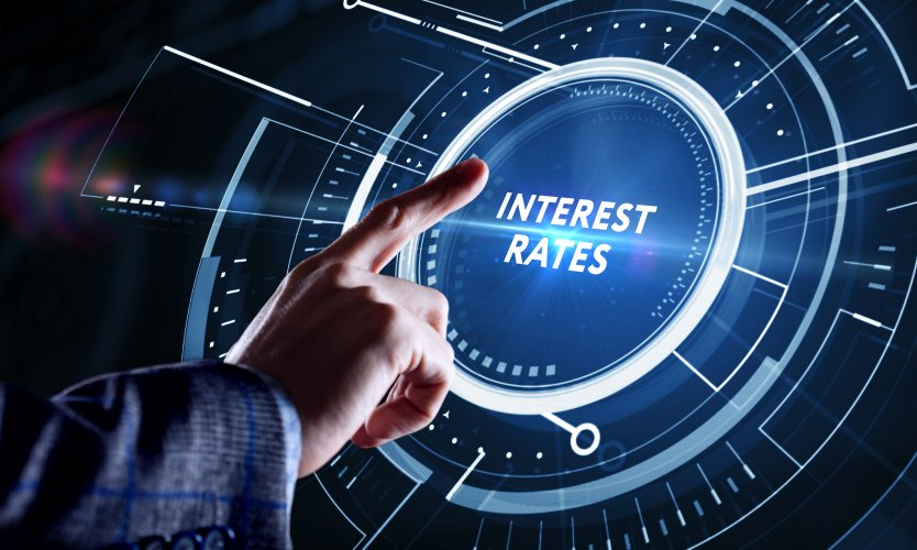 """Representative image of a hand pointing to the words """"interest rates"""""""