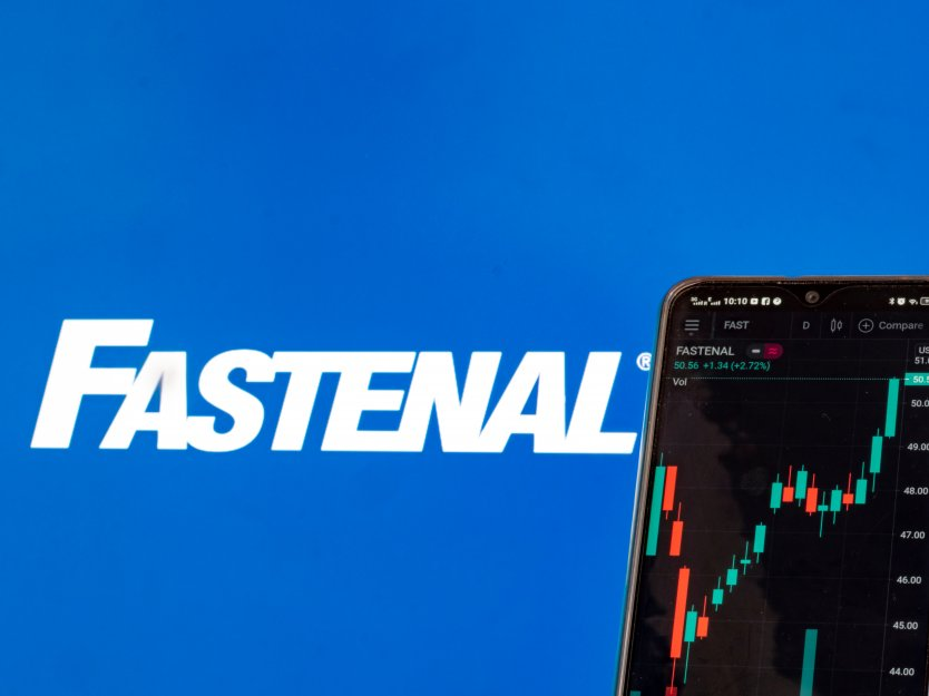 In this photo illustration the stock market information of Fastenal Company seen displayed on a smartphone with the Fastenal Company logo in the background.