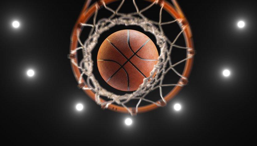 Bird's eye view of a basketball going through a hoop
