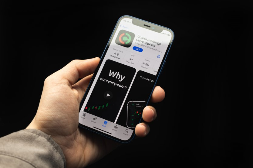 The Currency.com crypto exchange app as it appears ready to download on a mobile phone