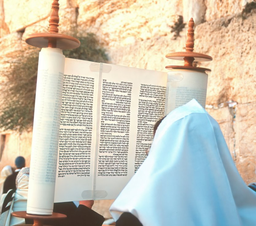 A Torah scroll is held up in front of the Wailing Wall, Jerusalem