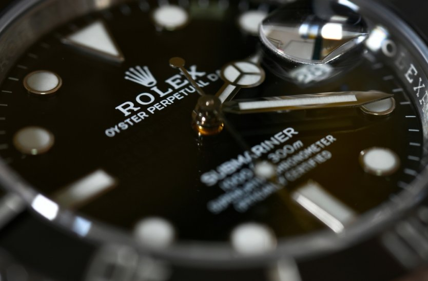 Close-up of a men's black Rolex Submariner wristwatch