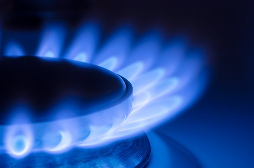A gas stove burner on full flame
