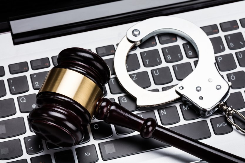 Image showing a gavel, handcuffs and keyboard to represent Internet Online Regulation