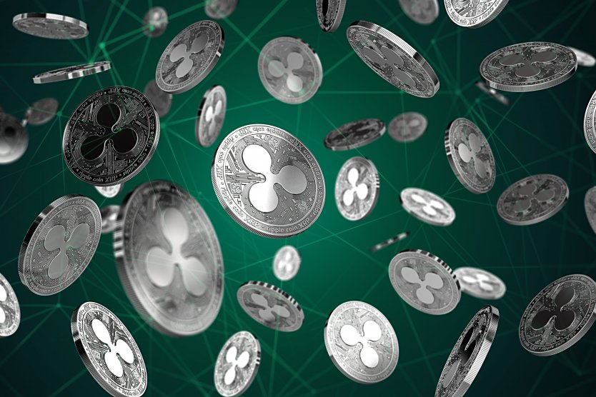 Ripple coins floating on green vectored background