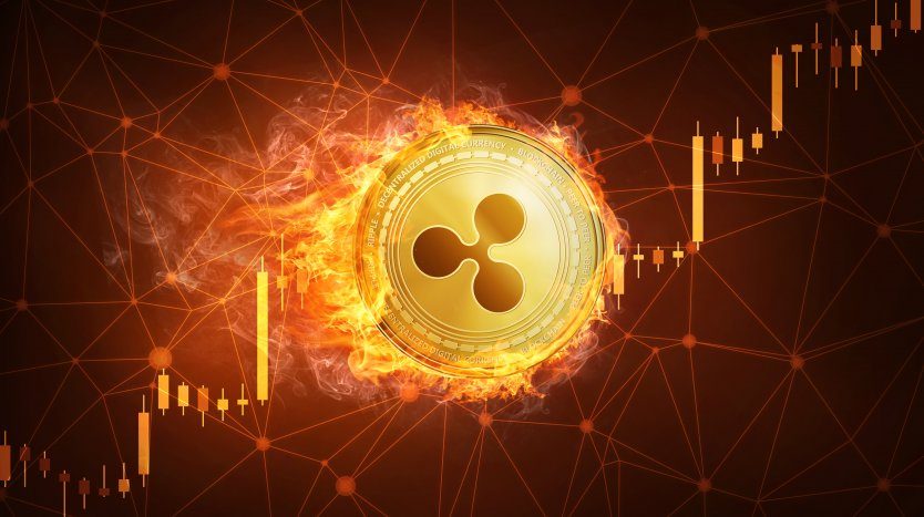 Ripple coin on fire with staggered arrows moving up